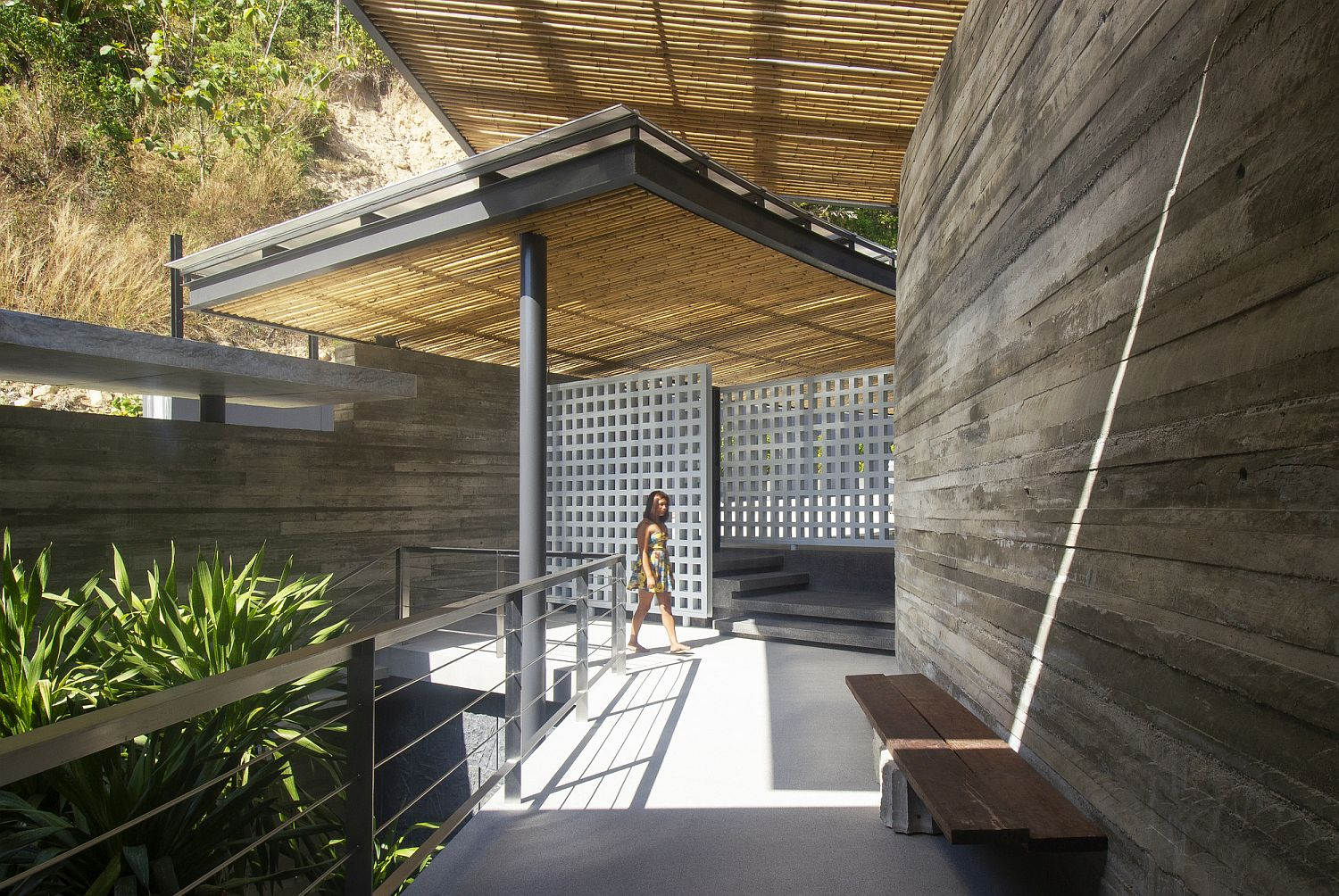 Bamboo screens offer ample shade throughout the house and keep away tropical sun