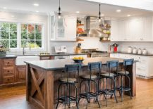 Bar-stools-and-woodsy-island-bring-rustic-touches-to-the-spacious-farmhouse-kitchen-217x155