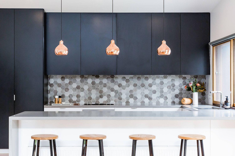 Beautiful gray hexagonal tiles for the custom kitchen backsplash