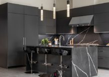 Black-cabinets-and-stone-kitchen-island-gives-the-contemporary-kitchen-a-polished-look-217x155