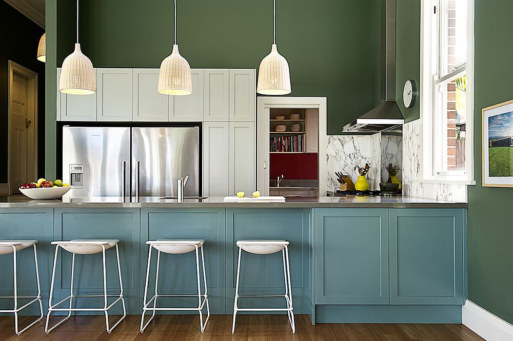 Blend of dark green and blue in the kitchen creates a picture of class and elegance