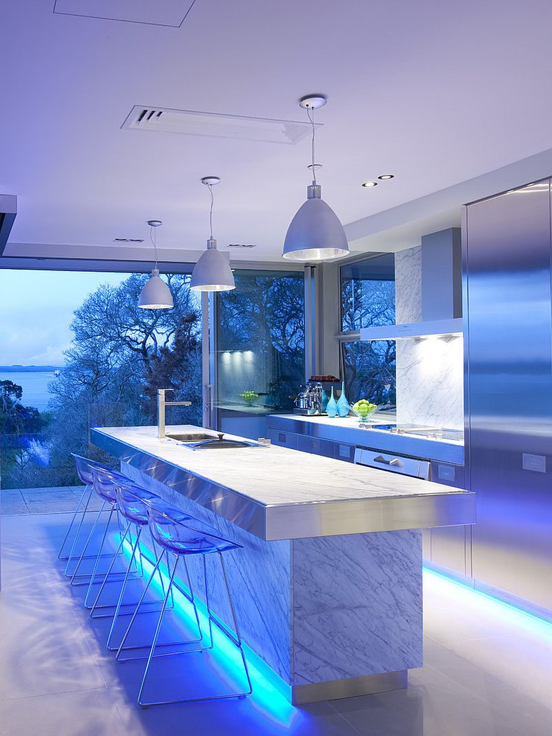 Blue strip LED lighting gives the island a levitating visual appeal