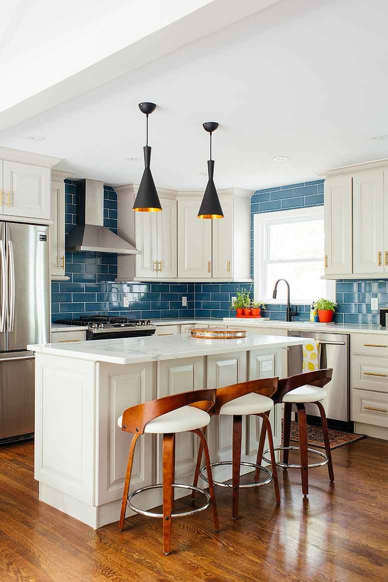 Blue subway tiles feel elegant and timeless in the light-filled modern kitchen