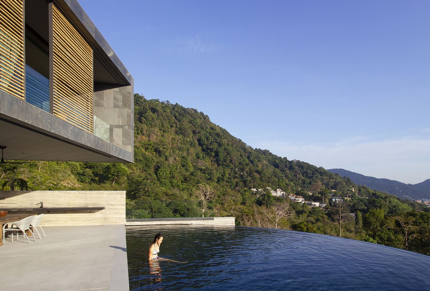 Breathtaking views of the Bay and beyond from the curved infinity pool