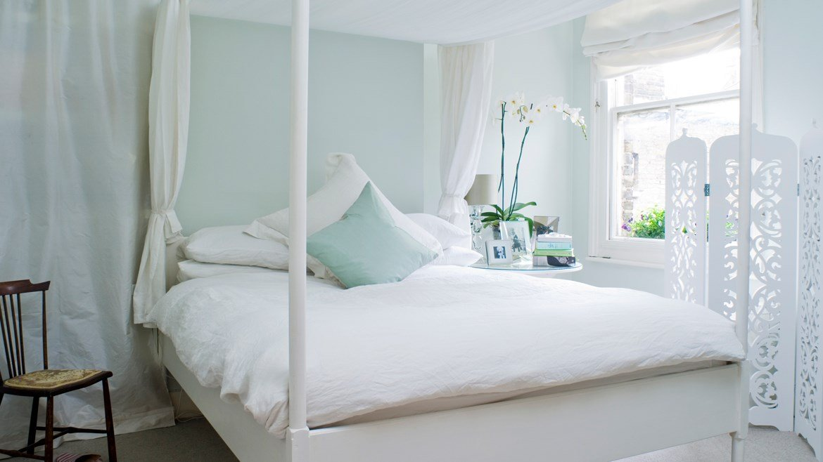 Breezy bedroom featuring paint from Farrow & Ball