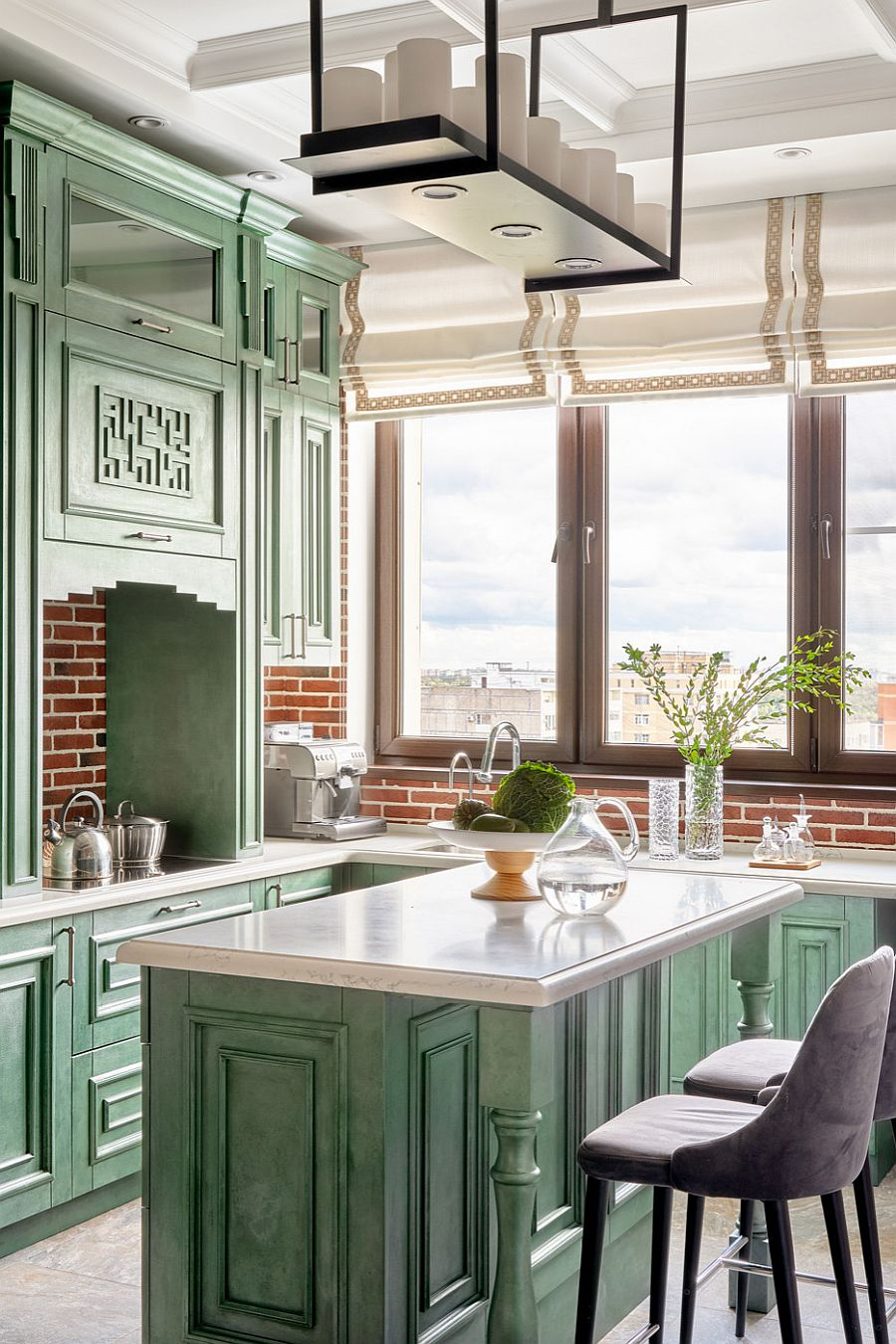 Brick coupled with darker shade of green in the modern-classic kitchen with unique cabinets