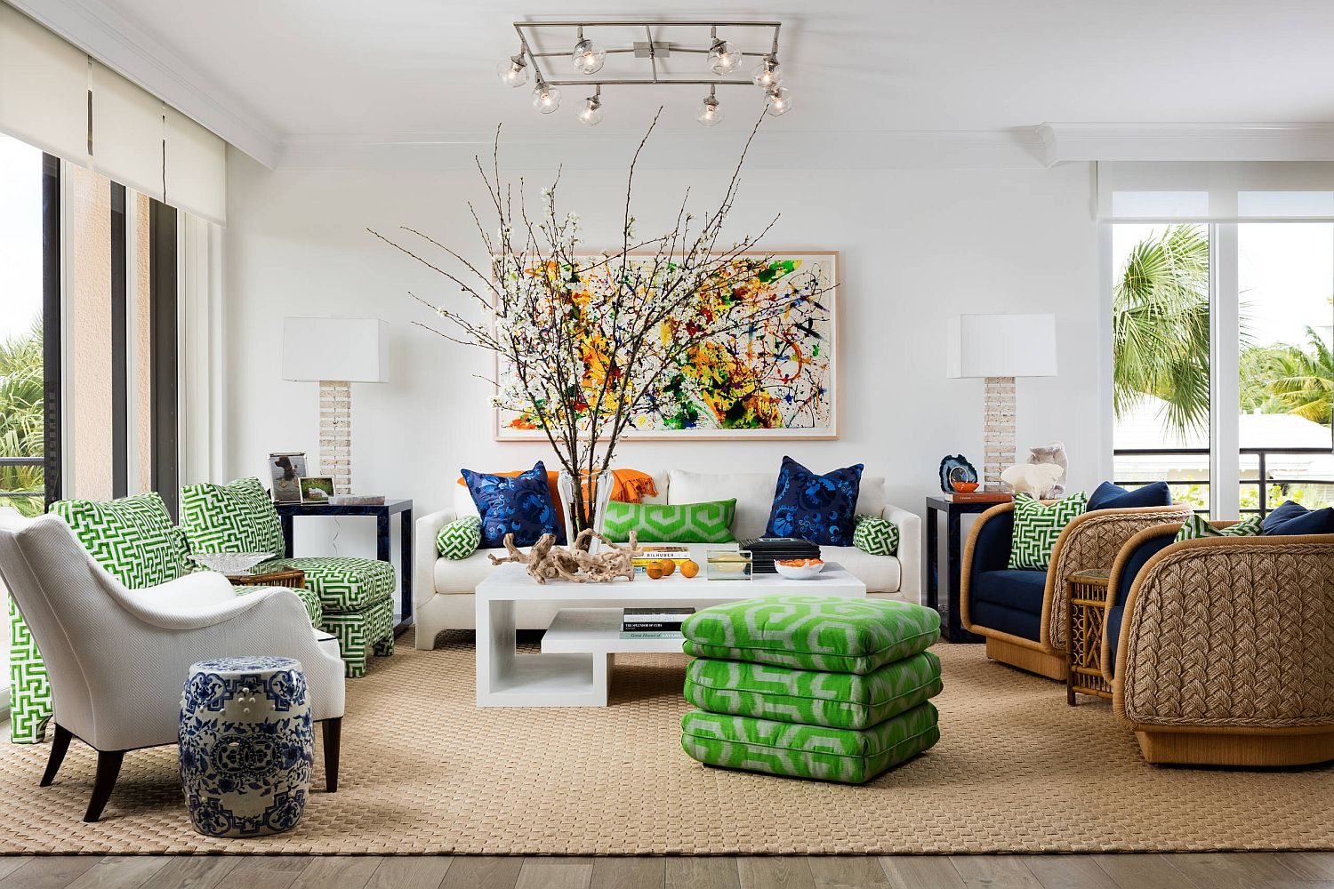 Bright pops of blue and green enliven this tropical style living room in white