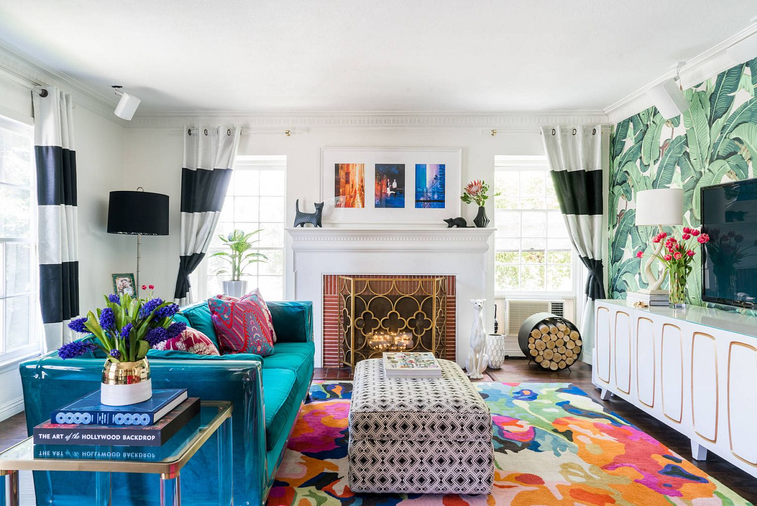 Brilliant blue couch and multi-colored rug for the small tropical style living space
