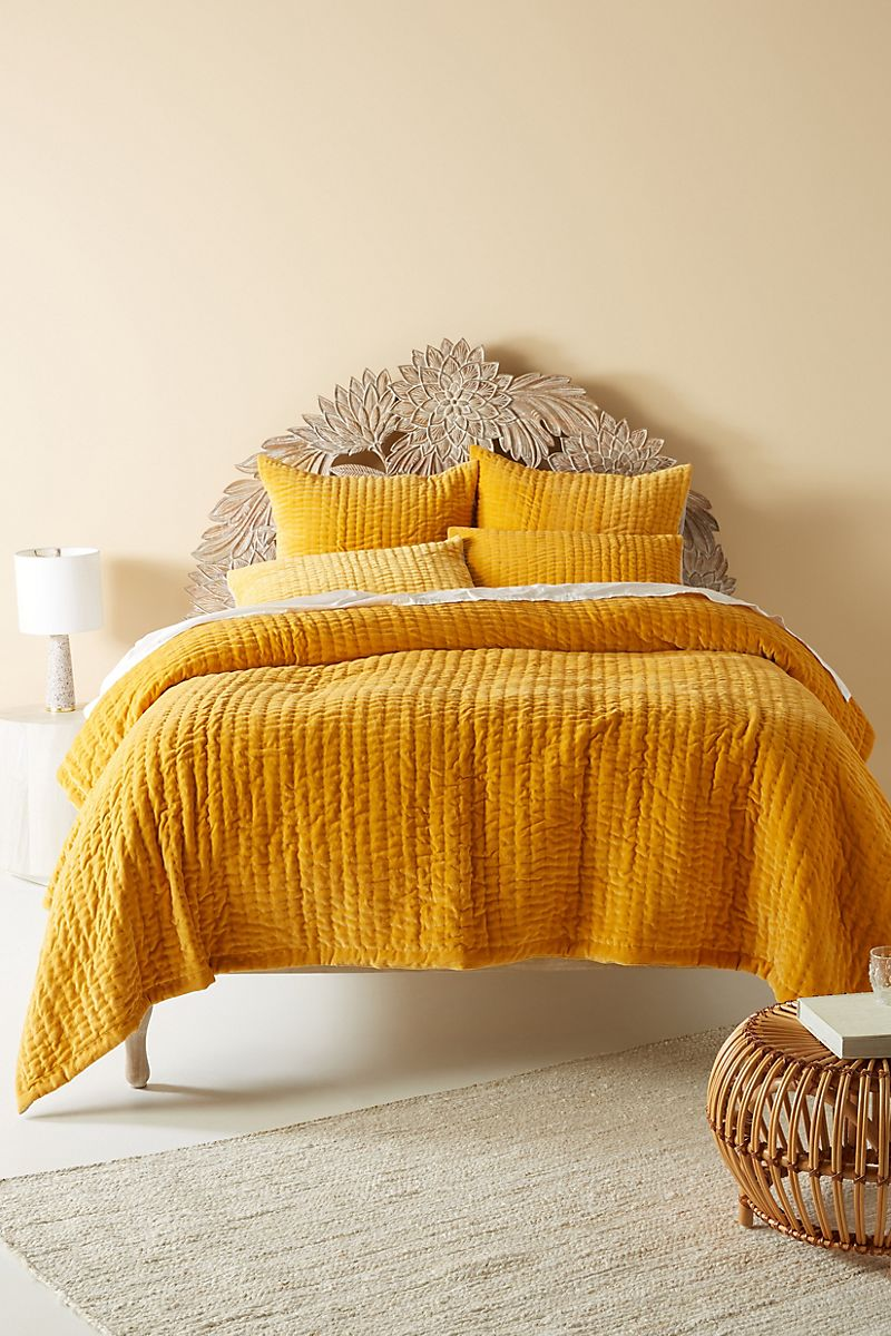 Buttery bedroom paint in a space by Anthropologie