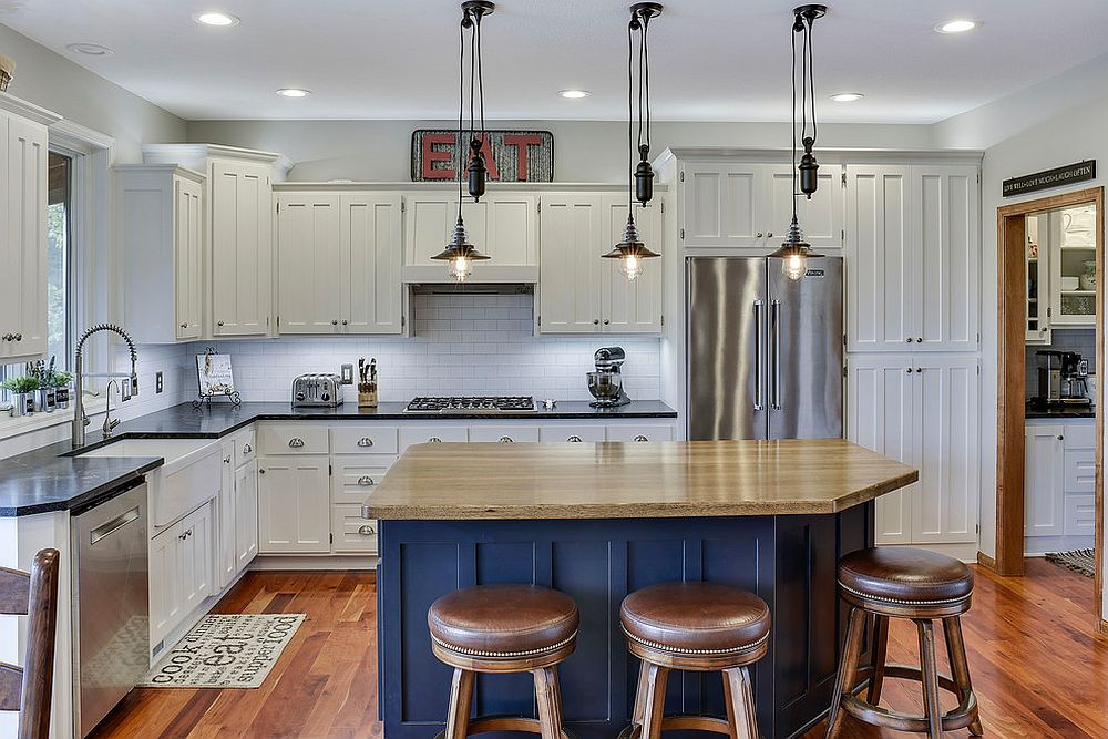 Cabinets draped in white enamel coupled with bright blue island in the kitchen