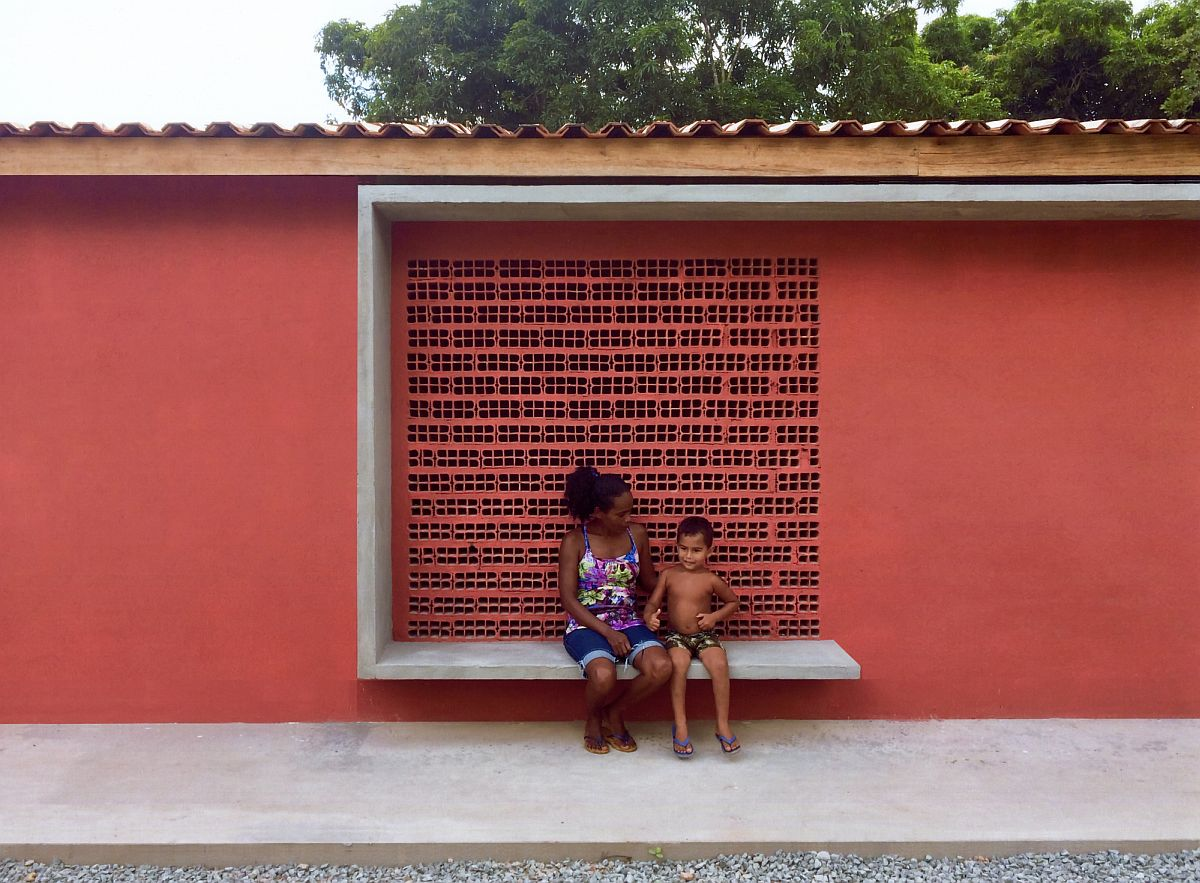 Ceramic bricks and reddish hue create a cool building that serves multiple tasks