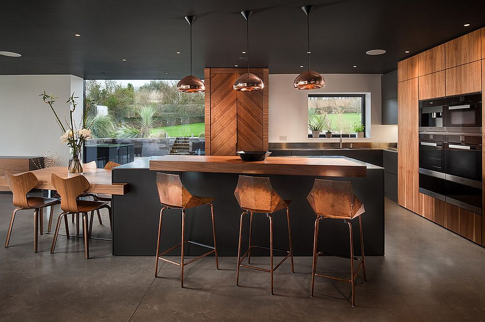 Chic-contemporary-bar-stools-along-with-sparkling-copper-pendant-lights-and-black-and-wood-kitchen-surfaces