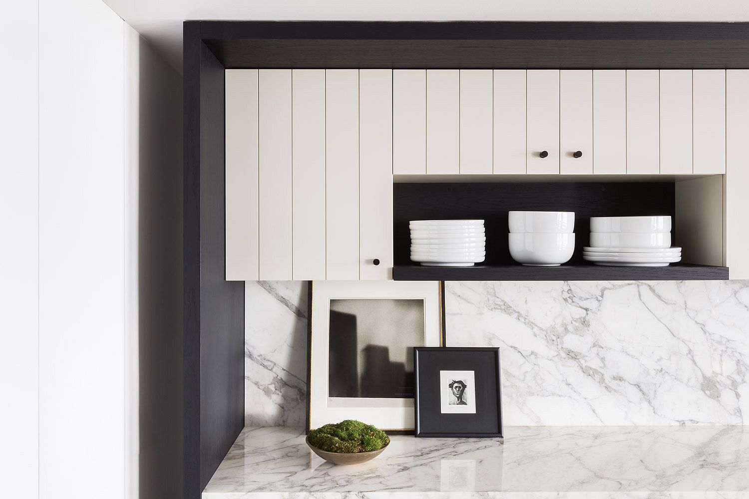 Closer look at the kichen shelving along with the posh marble finishes and backsplash