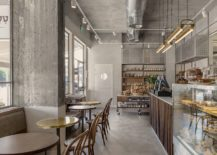 Concrete-and-exposed-duct-pipes-give-the-interior-a-distinct-industrial-appeal-217x155