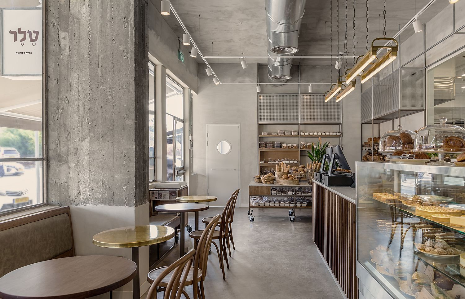 Concrete-and-exposed-duct-pipes-give-the-interior-a-distinct-industrial-appeal