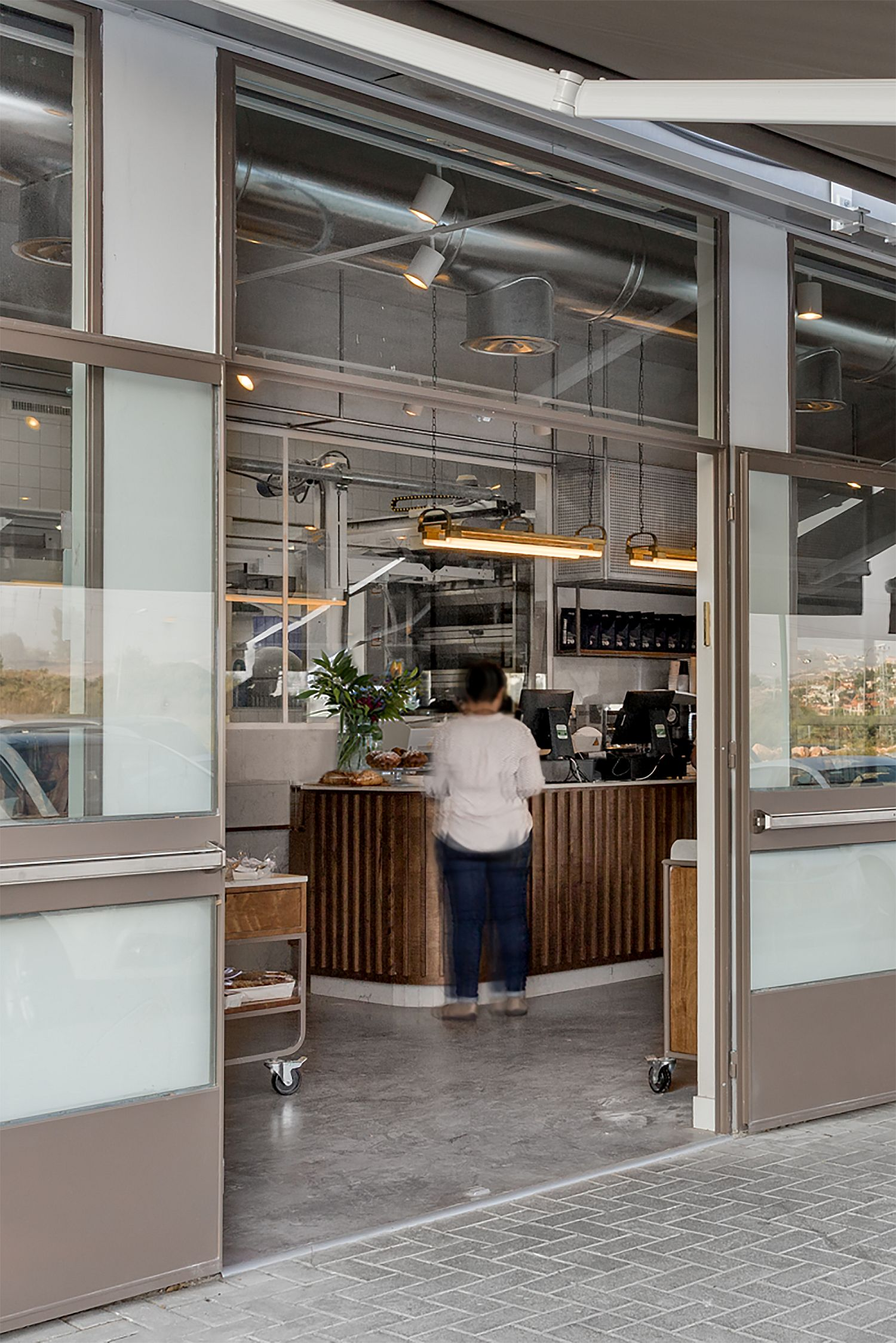 Concrete-metal-and-polished-finsihes-find-space-next-to-one-another-inside-the-bakery