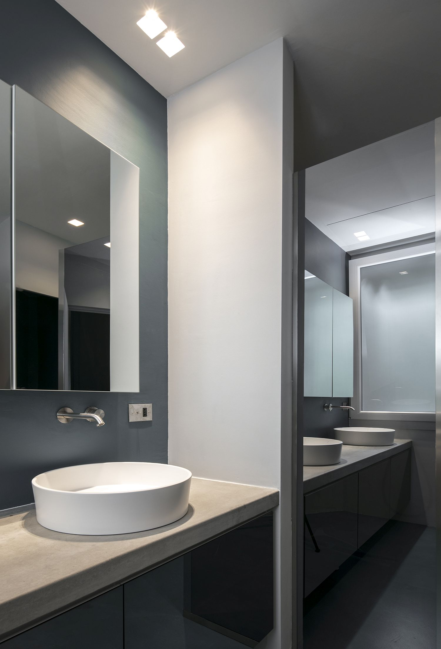 Contemporary bathroom in gray with lighting that is even and elegan