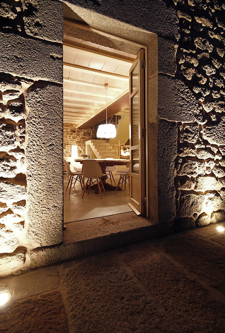 Cozy lighting and reclaimed stone walls create fabulous Spanish house with modren-rustic charm