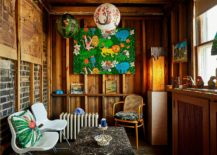 Cozy-small-tropical-living-room-of-Chicago-home-with-woodsy-wall-and-colorful-wall-art-217x155