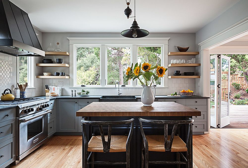 Craftsman-style-kitchen-with-lovely-blue-cabinets-and-a-small-wooden-island-at-its-heart