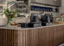 Curved-front-desk-at-the-Teller-Bakery-gives-it-distinct-identity-217x155