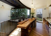Curved-wooden-island-with-bespoke-design-that-steals-the-spotlight-217x155