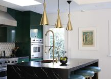Dark-green-cabinets-coupled-with-black-kitchen-island-and-dazzling-copper-pendant-lights-217x155