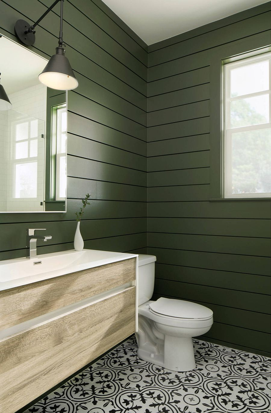 Dark green with matte finish shapes the walls of the beautiful modern bathroom