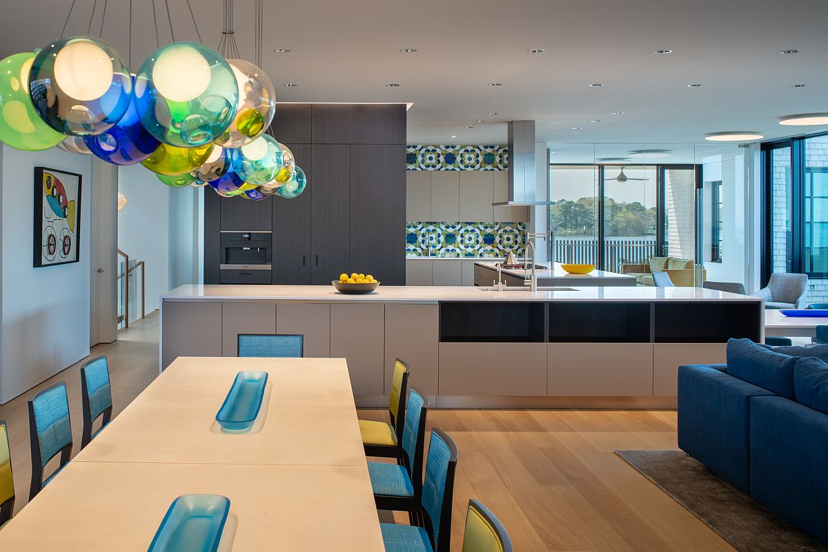 Dining area with ample natural lighting aling with colorful pendant lights
