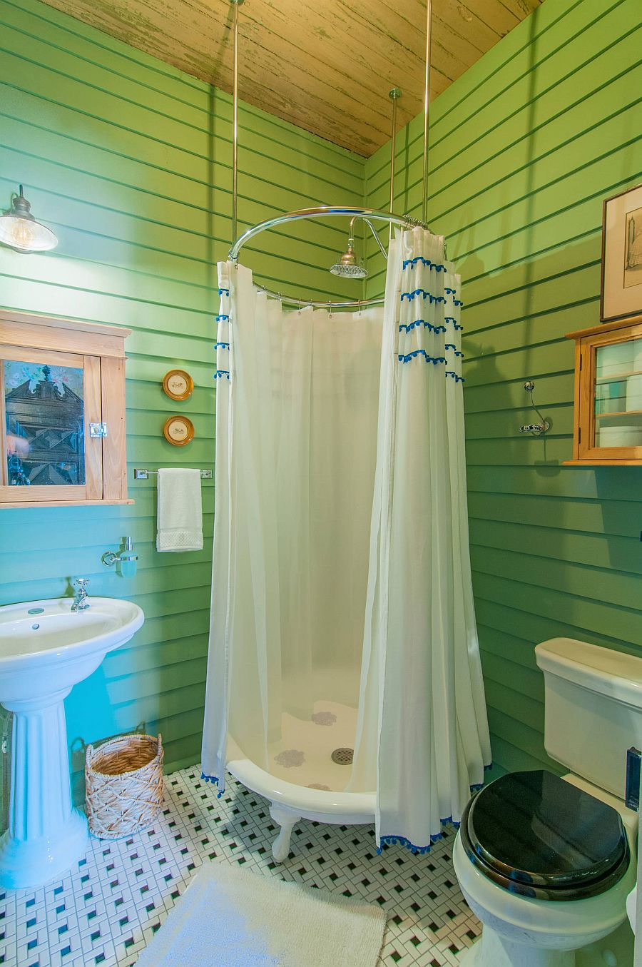Eclectic bathroom with a fun shower zone and walls in green