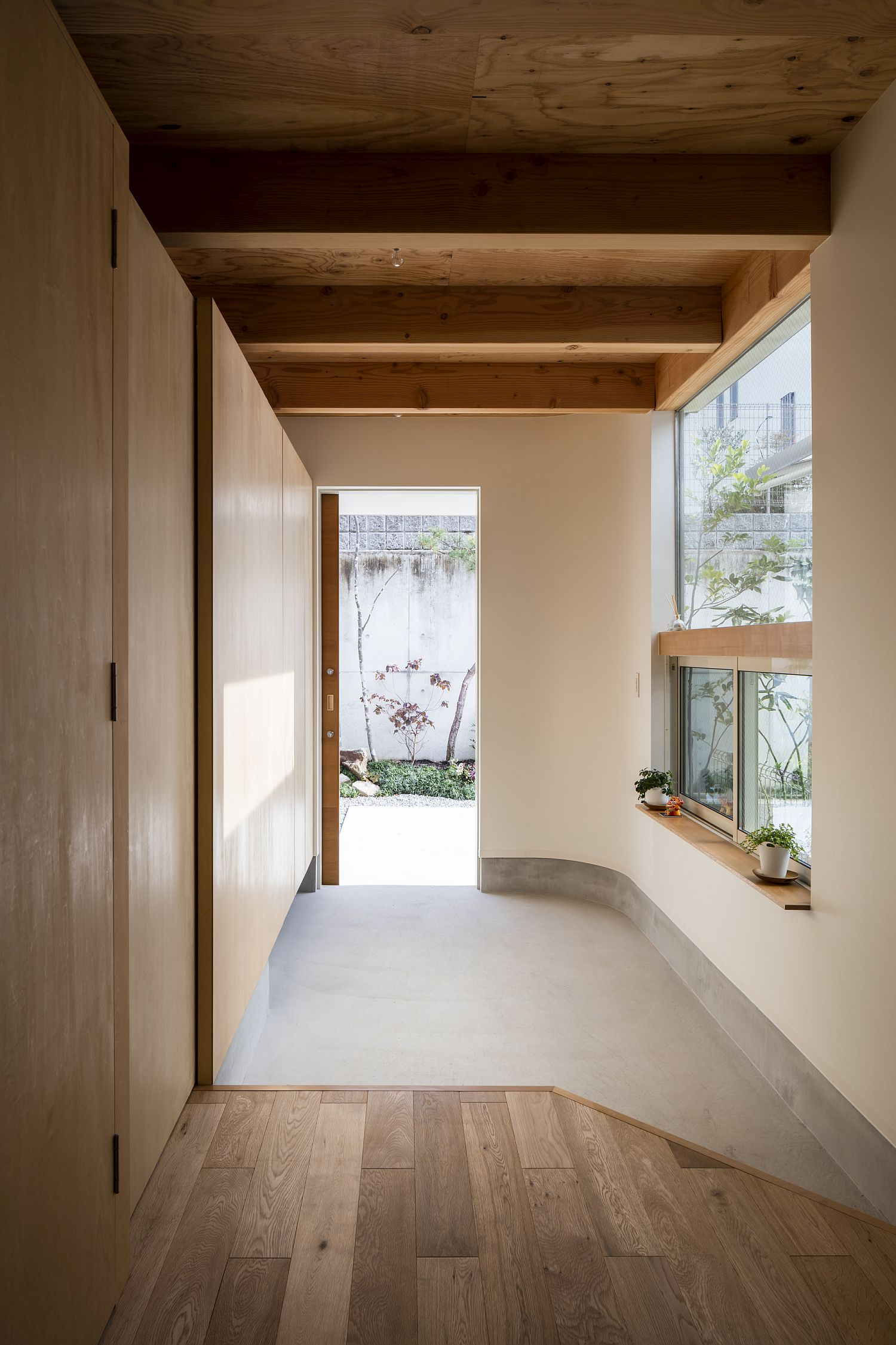 Entry and Japanese room welcome guests at this narrow home that is space-savvy and eco-friendly