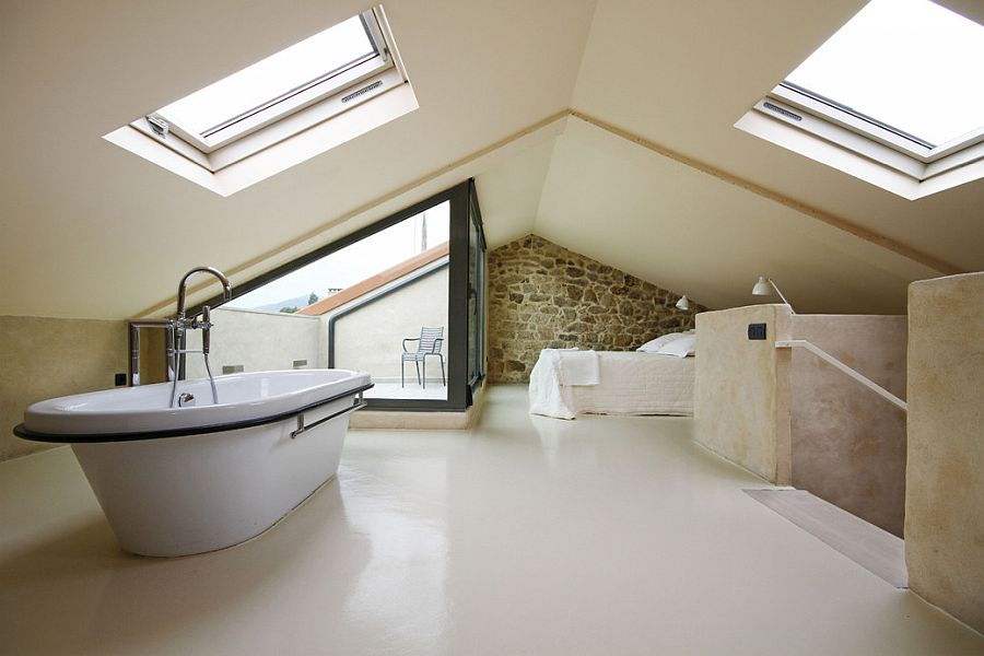 Exquisite upper level bedroom of the revamped Spanish House in stone with ample natural light