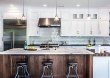 Exquiste-kitchen-of-New-York-home-with-backdrop-in-white-subway-tiles-and-wooden-island-217x155