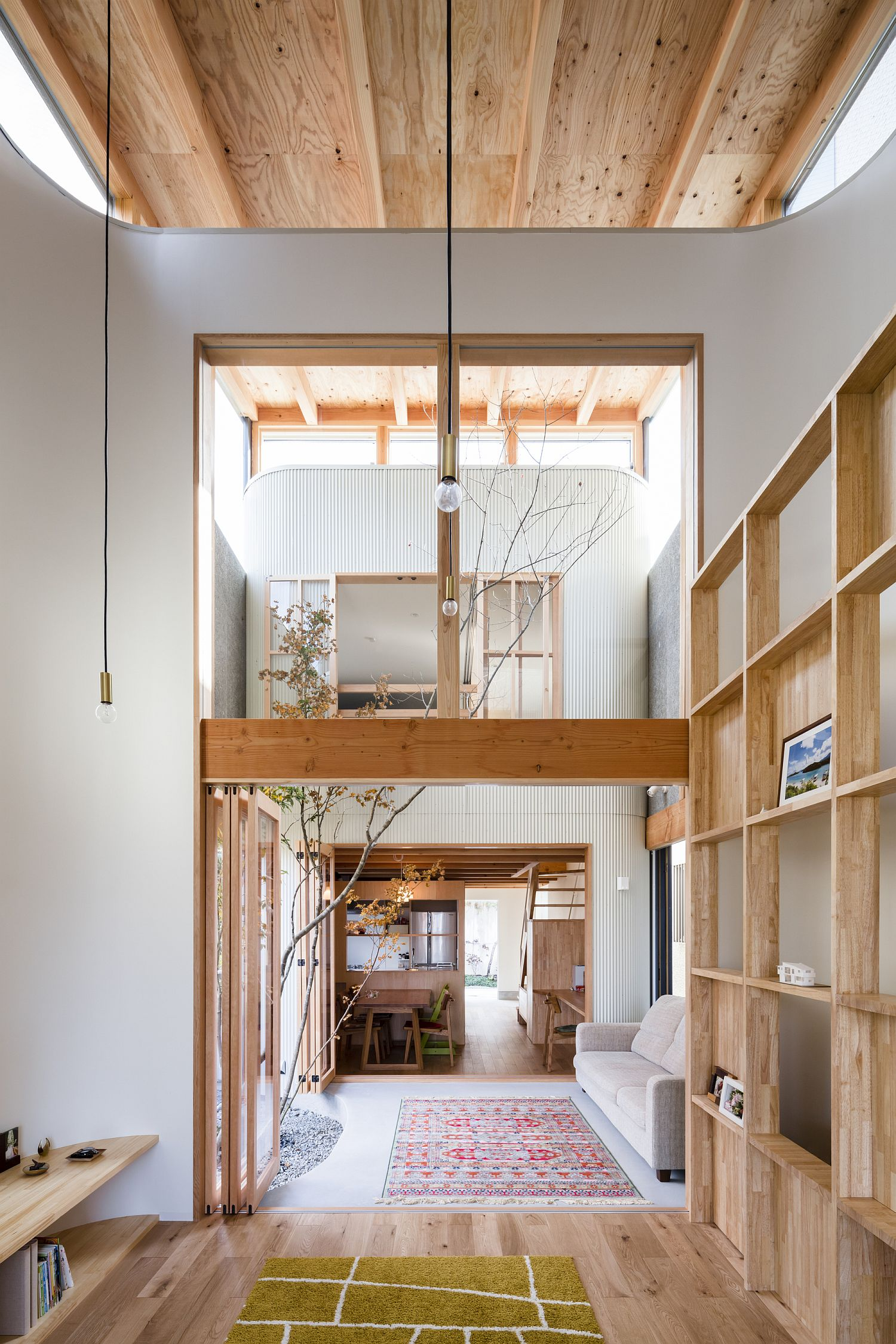 Fabulous Japanese home in white and wood with a breezy, double-height interior