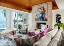 Fireplace-with-colorful-wall-art-sits-at-the-heart-of-the-breezy-tropical-living-room-of-Miami-Home-217x155