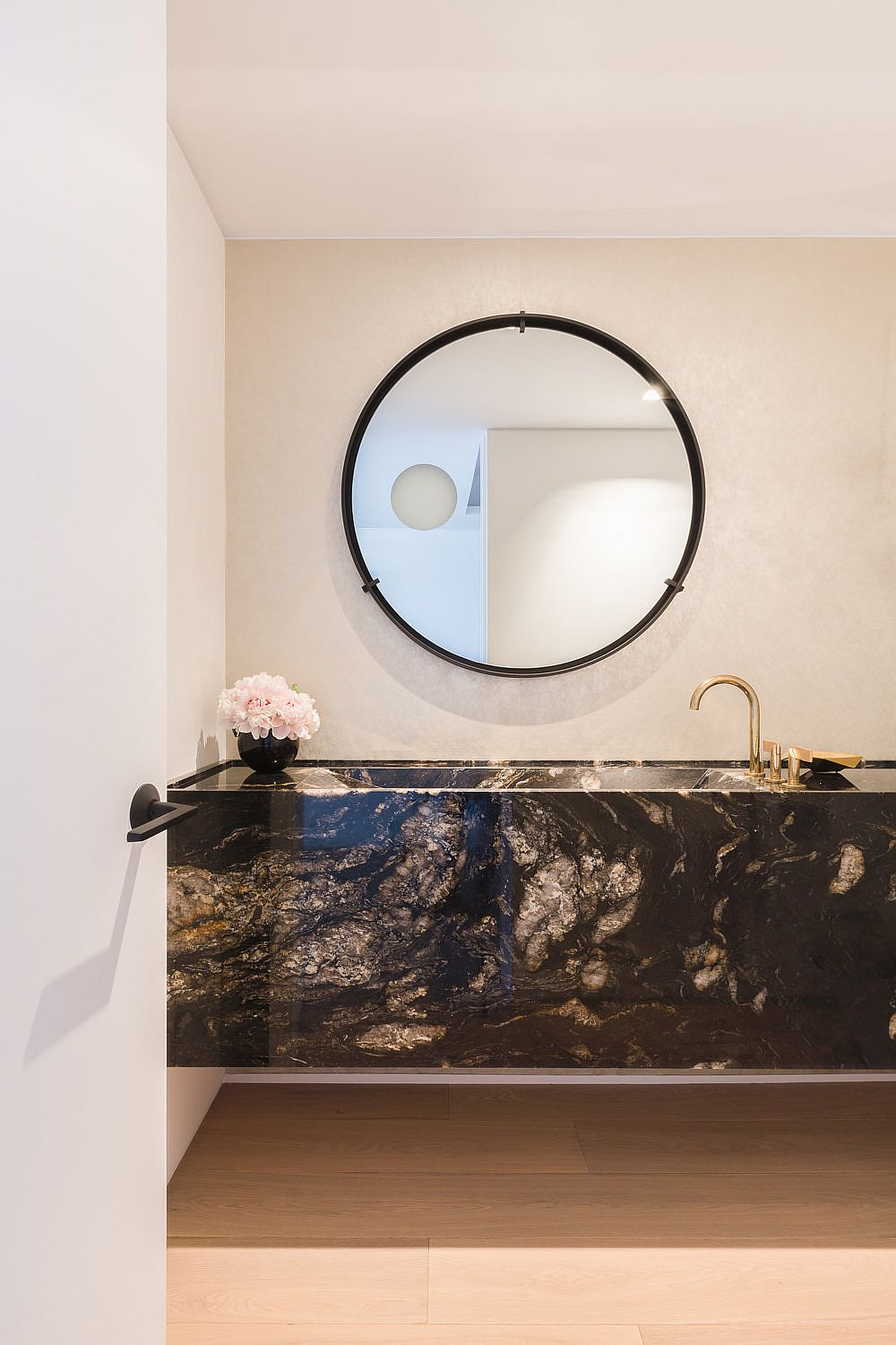 Floating stone vanity in the modern bathroom instantly grabs your attention
