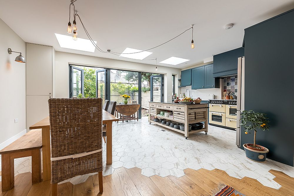 Floor tiles usher in geometric contrast into the kitchen dominated by white and wood