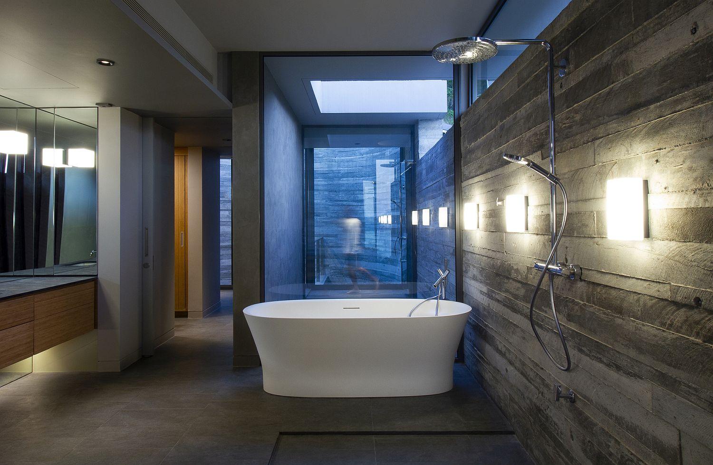 Freestanding bathtub in white for the concrete contemporary bathroom