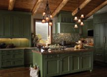 Gallery-kitchen-of-mountain-retreat-with-dark-green-cabinets-woodsy-ceiling-and-stone-surfaces-all-around-217x155
