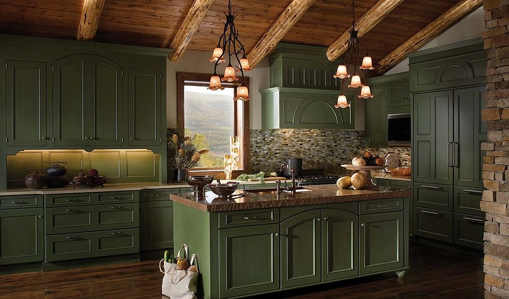 Gallery kitchen of mountain retreat with dark green cabinets, woodsy ceiling and stone surfaces all around