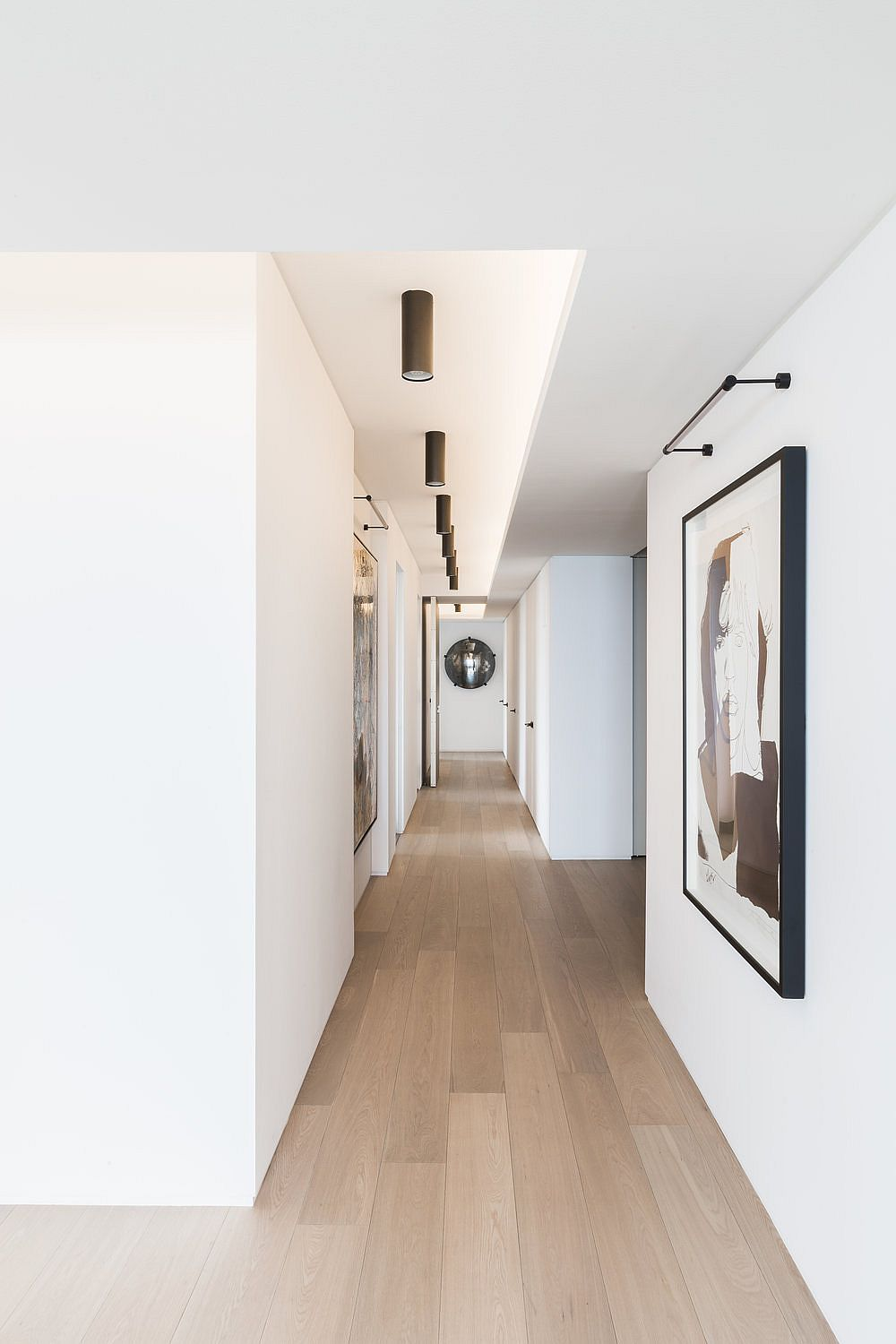Gallery-style long corridor inside the Water Tower Flat in Chicago