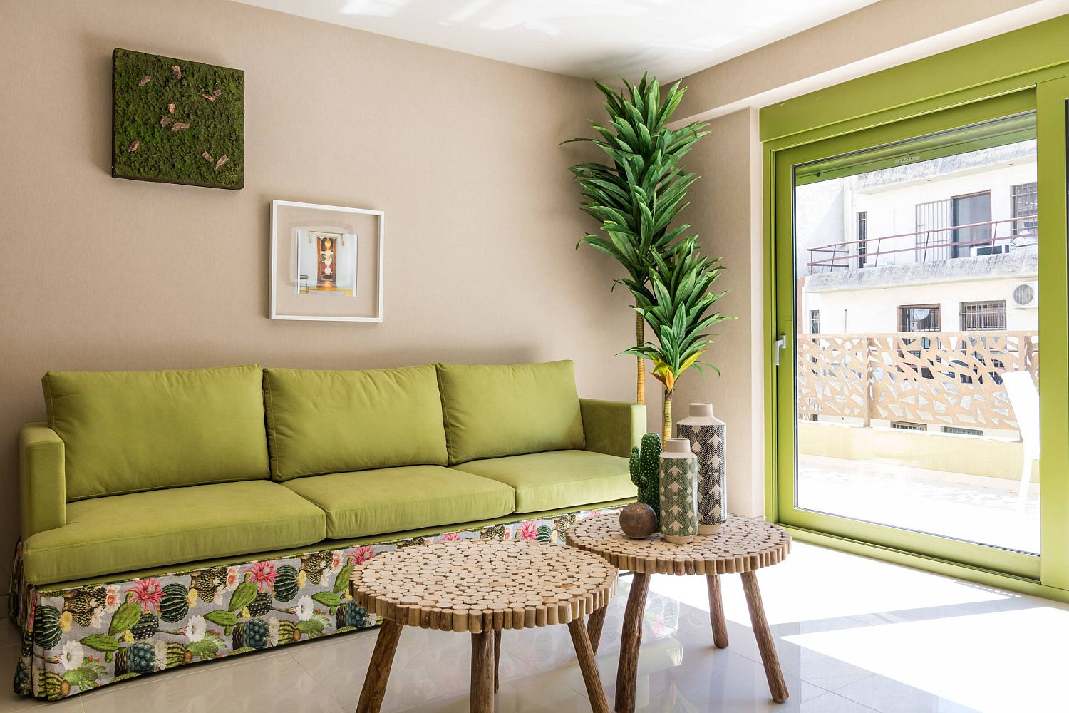 Giving the small living room color using pops of green