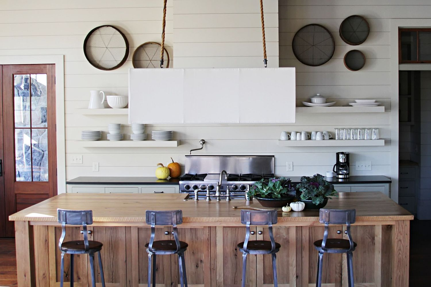 Gorgeous modern kitchen with a white backdrop and a fabulous wooden island
