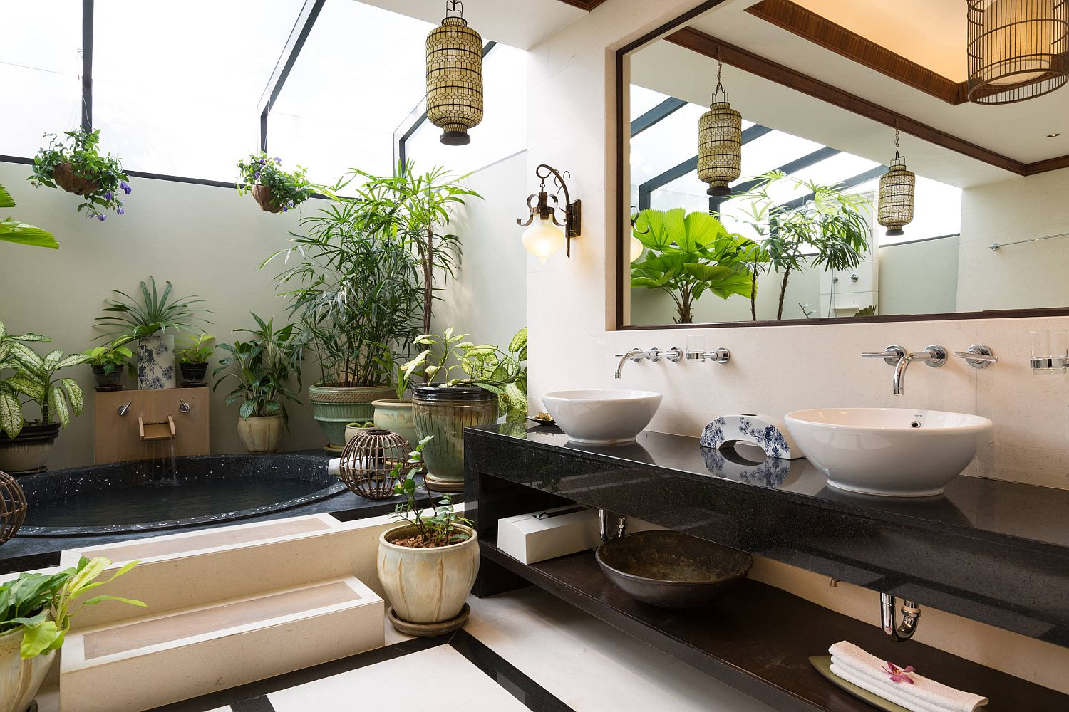 Greenery, skylights and wood give the bathroom a stunning and relaxing vibe