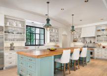 Island-brings-blue-to-the-modern-beach-style-kitchen-in-white-217x155