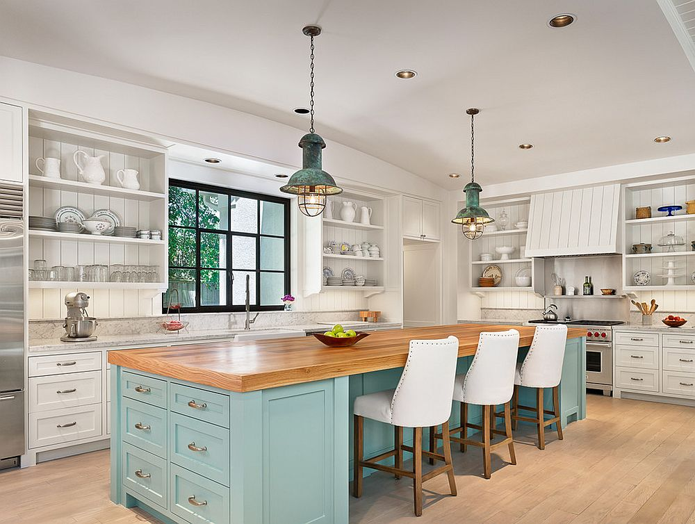 Island brings blue to the modern beach style kitchen in white