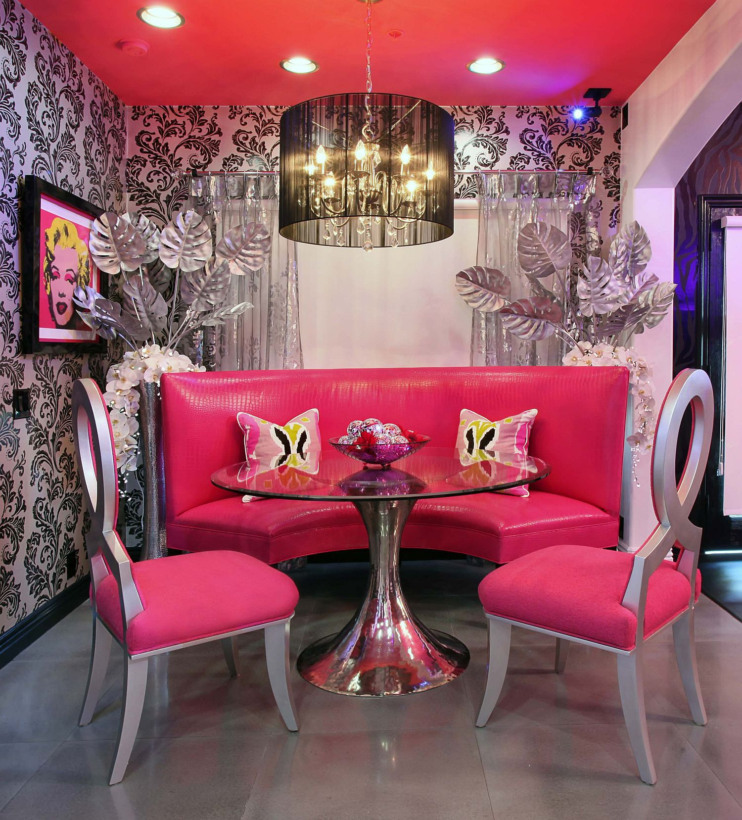 It is ceiling that ushers pink into the unique dining room that also fetaures Breast Cancer Awarness Chairs