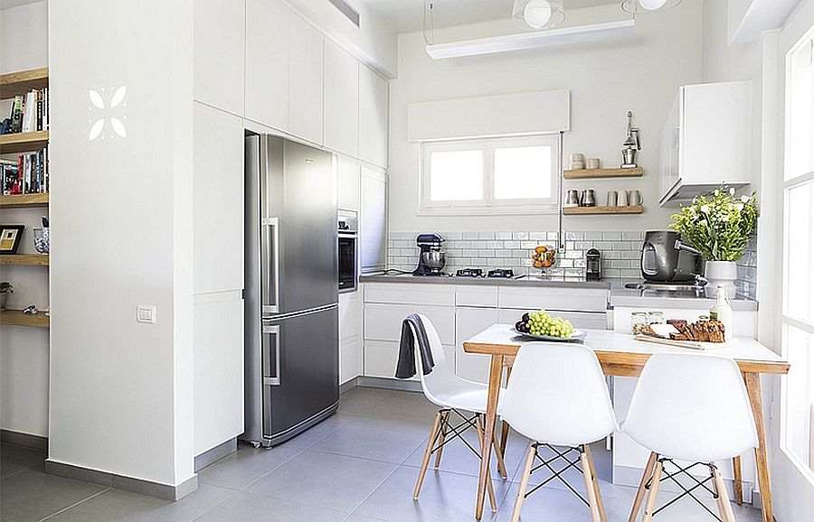 Just a hint of wood for the space-savvy small kitchen in white