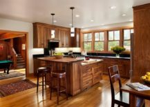Kitchen-draped-entirely-in-wood-with-an-island-to-match-its-beautiful-cabinets-217x155
