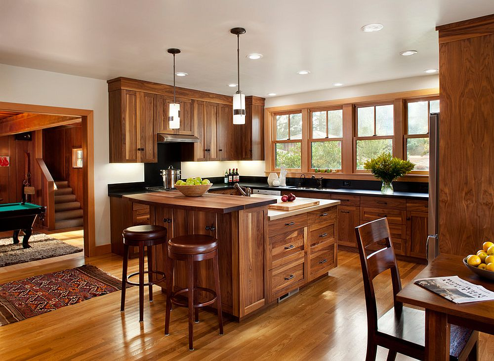 Kitchen-draped-entirely-in-wood-with-an-island-to-match-its-beautiful-cabinets